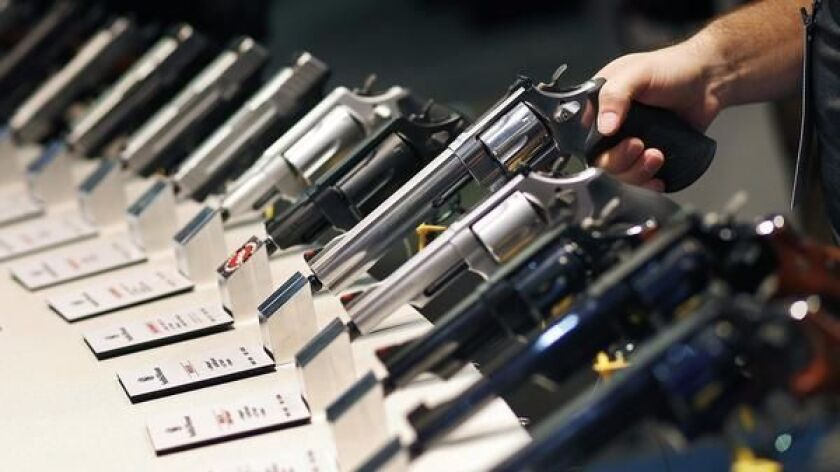 FILE - In this Jan. 19, 2016 file photo, handguns are displayed at the Smith & Wesson booth at the Shooting, Hunting and Outdoor Trade Show in Las Vegas.