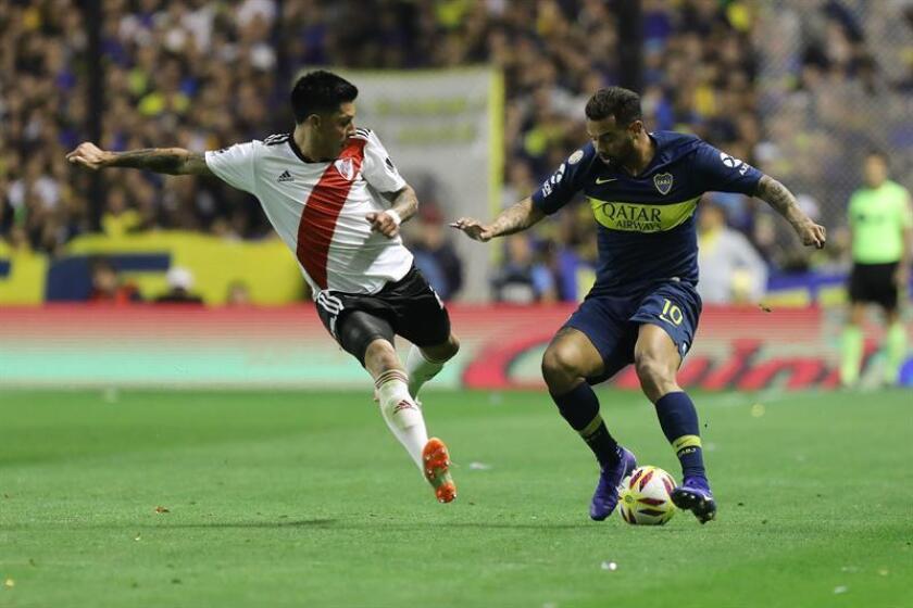 Boca Juniors midfielder Edwin Cardona (R) fights for the ball with River Plate's Exequiel Palacios (L)during the Superliga Argentina match played on Sept. 23, 2018, at La Bombonera Stadium in Buenos Aires, Argentina. EPA-EFE FILE/Juan Ignacio Roncoroni