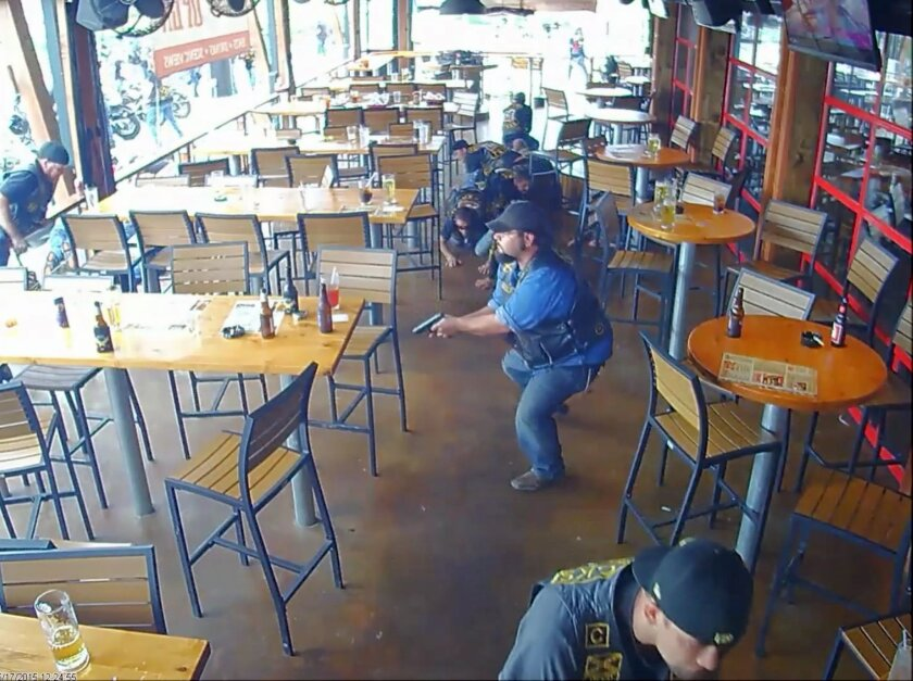In this image made from surveillance video, members of a motorcycle club react to a shooting at a Twin Peaks restaurant in Waco, Texas on May 17, 2015. On Friday, Oct. 30, 2015, The Associated Press published surveillance video and photos of the Twin Peaks restaurant where the deadly shooting occur