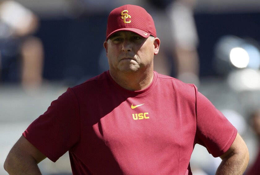USC coach Clay Helton watches his players warm up before Saturday's game against BYU.