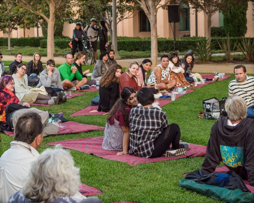 """An audience watches Jesca Prudencio's """"PDA"""" at La Jolla Playhouse's 2019 Without Walls Festival at Liberty Station."""
