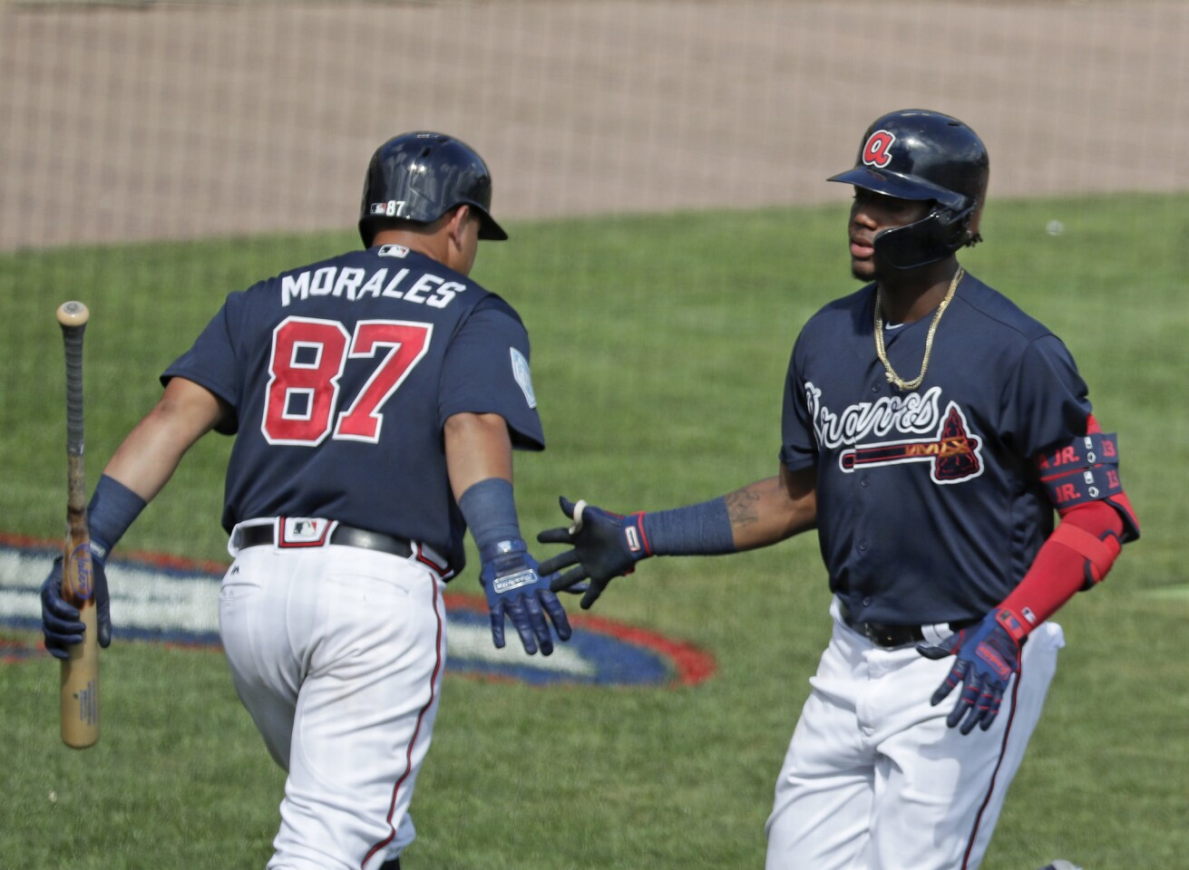 Atlanta Braves' Jonathan Morales, left, congratulates teammate Ronald Acuna Jr., right, on his sixth inning home run against the Houston Astros in a spring baseball exhibition game, Monday, March 4, 2019, in Kissimmee, Fla. (AP Photo/John Raoux)