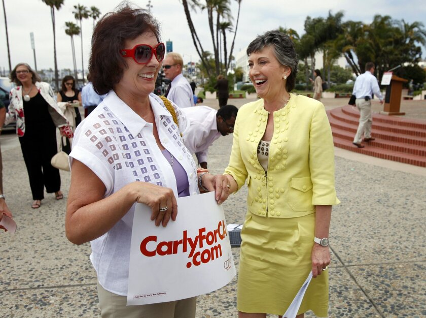 Republican U.S. Senate candidate Carly Fiorina (right) laughs with supporter Ursula Kuster during a visit to San Diego on Monday, as candidates made last-minute appeals for votes.