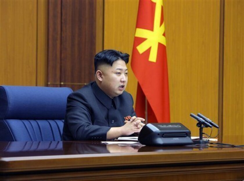 In this undated photo released by the Korean Central News Agency and distributed Sunday, Feb. 3, 2013 in Tokyo by the Korea News Service, North Korean leader Kim Jong Un attends an enlarged meeting of the Central Military Commission of the Workers' Party of Korea at an undisclosed location of North