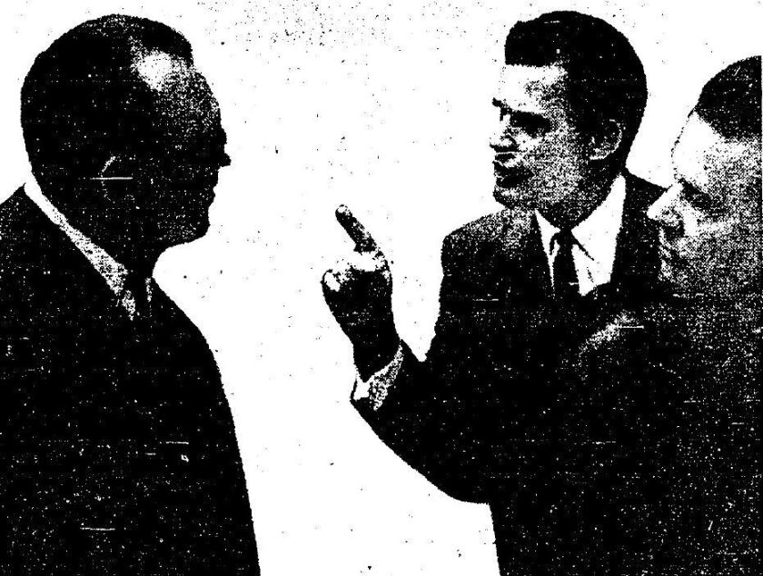 Actor James Garner, center, points at L.A. Councilman Karl Rundberg, left, during an argument about the Santa Monica Mountains. The Los Angeles Times published this photo July 30, 1964.