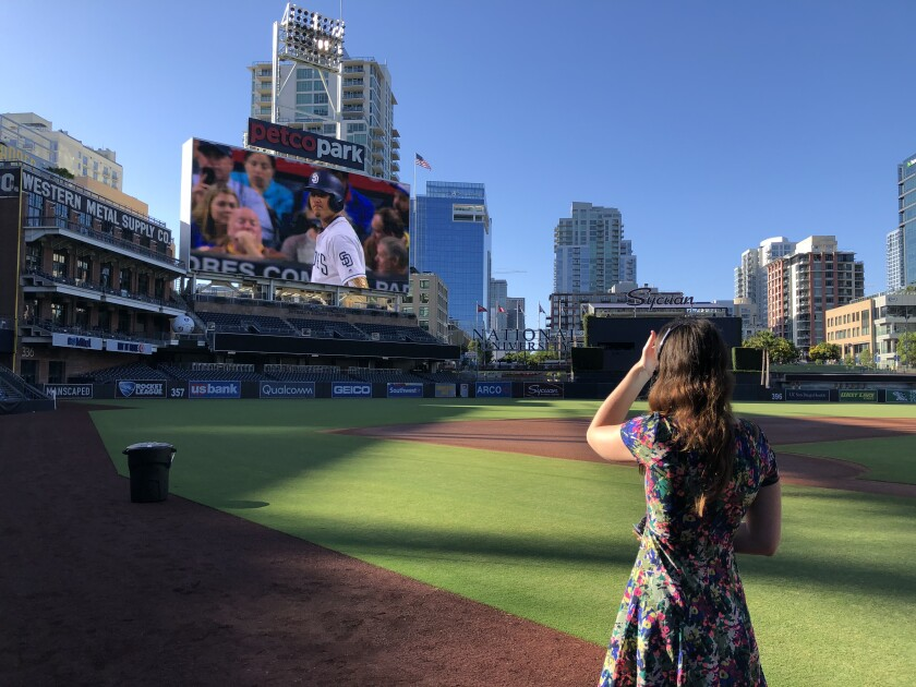 Padres producer of game day presentation Shannon Landers works to coordinate action on the field with artificial crowd noise.