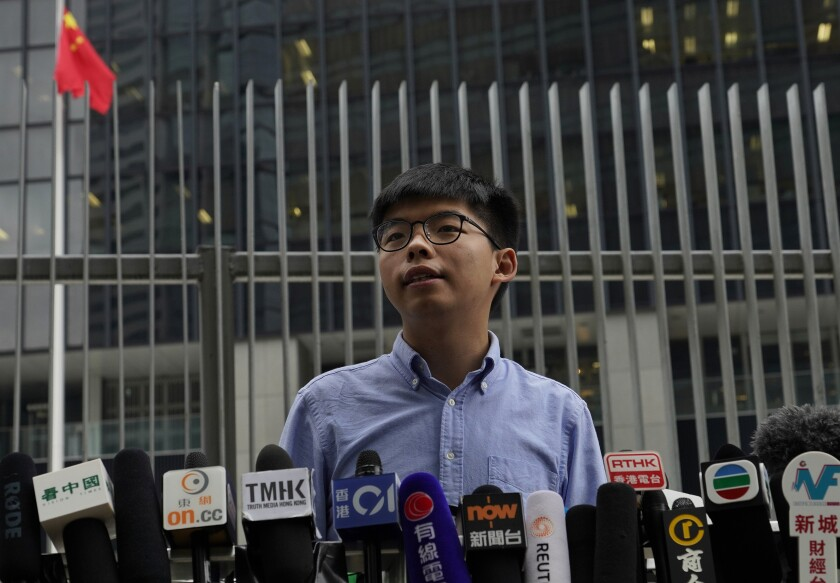 Pro-democracy activist Joshua Wong, speaking at an Oct. 29 news conference, became the young face of Hong Kong protests in 2014.