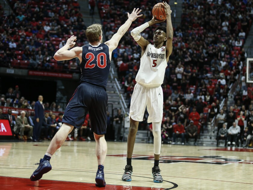 SDSU forward Jalen McDaniels (5) shoots for three while Fresno State forward Sam Bittner (20) defends in the second half.
