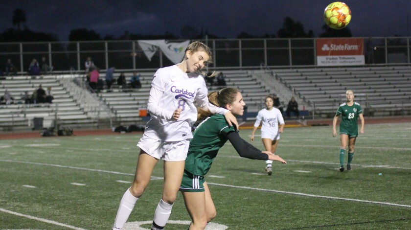 Carlsbad senior Marisa Bubnis goes over the top for a header.