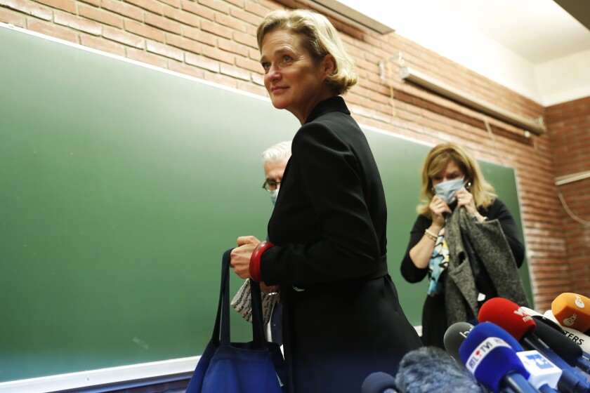Belgium's artist and sculptor Delphine Boel leaves after a press conference in Brussels, Monday, Oct. 5, 2020. Artist and sculptor Delphine Boel is on the cusp of officially becoming a Belgian princess after a Brussels court on Thursday, Oct. 1, 2020 ruled in her favor in a decades-old royal paternity scandal pitting her against former King Albert II. (AP Photo/Francisco Seco)