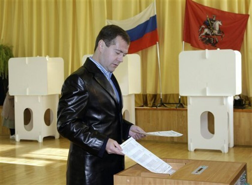 Russian President Dmitry Medvedev places his election ballot into the scanner at a polling station during municipal elections in Moscow on Sunday, Oct. 11, 2009. Russian media report that polls are open in municipal and local elections across the country, including Chechnya, Ingushetia and other violence-plagued regions of the Caucasus.(AP Photo/ RIA Novosti, Vladimir Rodionov, Presidential Press Service)