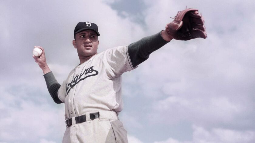 Don Newcombe, pitcher for the Brooklyn Dodgers baseball team is shown posing, March 1951. (AP Photo