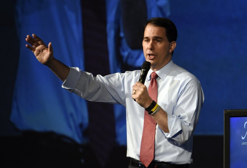 Republican presidential candidate Wisconsin Gov. Scott Walker speaks at the American Legislative Exchange Council 42nd annual meeting Thursday, July 23, 2015, in San Diego. (AP Photo/Denis Poroy)