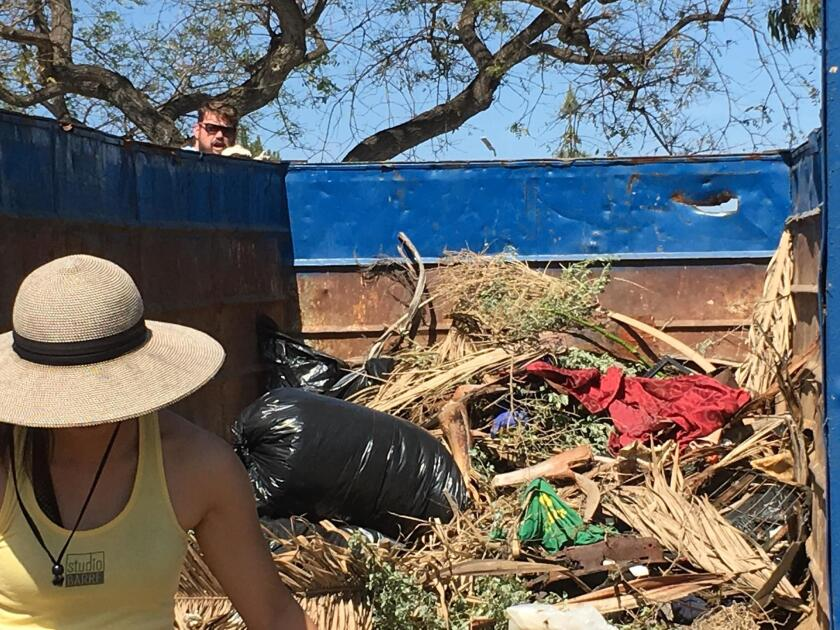 Volunteers clear out dead brush, plastics and assorted rags from Rose Creek.