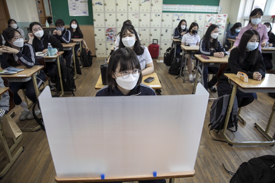Students at Gyungbuk Girls' High School await the first bell on their first day back after school closures in Daegu, South Korea, due to the COVID-19 pandemic. High school seniors were the first to resume classes in the country.