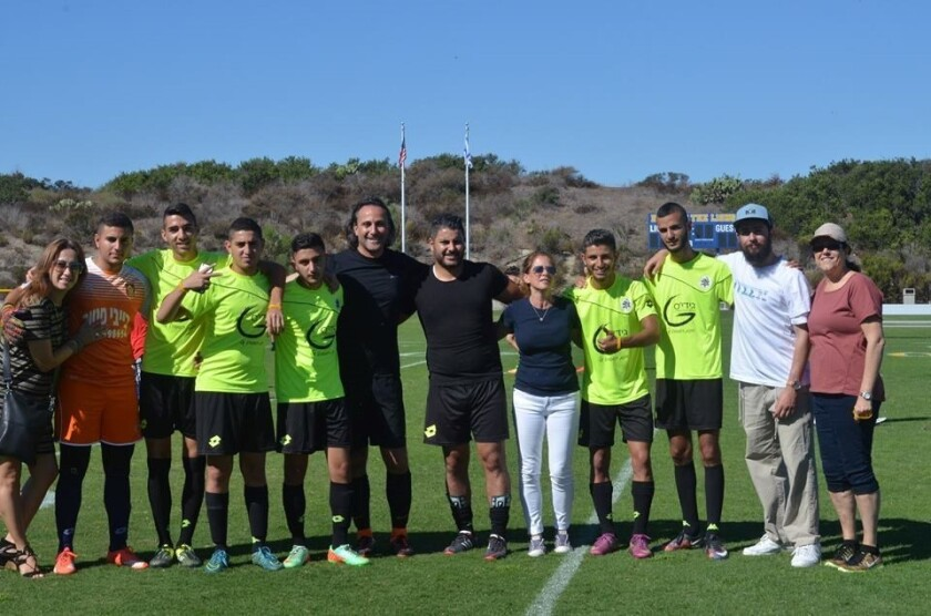 The Sderot Soccer Team with host family member Jodi Sandler, Doron Malka, Adopt a Family Foundation Board co-founder Carine Chitayat and Jenny Michan, committee member.