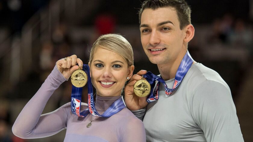 Alexa Scimeca-Knierim and Chris Knierim pose after they won the pairs competition at the 2018 U.S. Figure Skating Championships last month in San Jose.