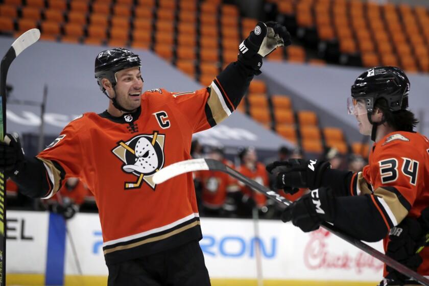 Ducks center Ryan Getzlaf celebrates with defenseman Jamie Drysdale.