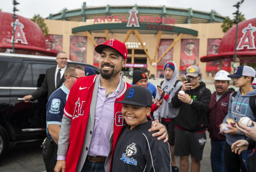 Newly signed Angels third baseman Anthony Rendon poses for a photo with fan Jesse Olivan.