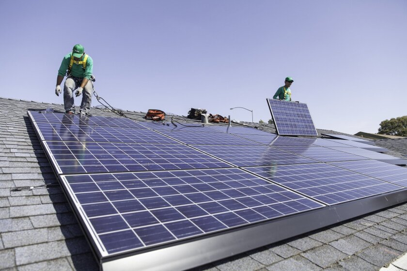 In this undated photo provided by SolarCity, workers install solar panels on the roof of a home. SolarCity will begin offering loans to homeowners for rooftop solar systems, a move that analysts say could reshape the market for rooftop solar and propel its rapid adoption. (AP Photo/Courtesy SolarCity)