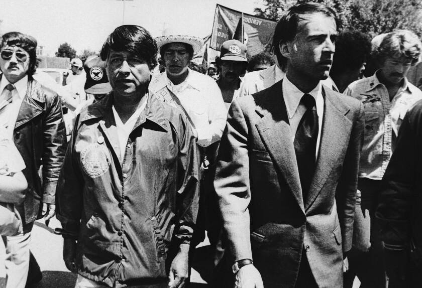 Gov. Edmund Brown Jr. walks next to Cesar Chavez as hundreds of farmworkers follow.
