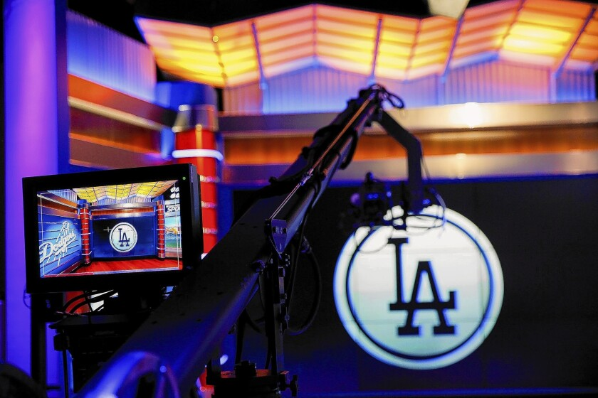 Time Warner Cable wants other pay-TV providers to charge all their customers about $5 a month for the Dodgers channel SportsNet LA. DirecTV, Verizon, AT&T and Dish Network have refused. Above, the SportsNet LA studio.
