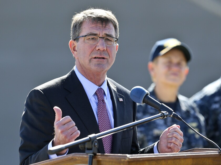 Secretary of Defense Ashton Carter answers questions while talking with Navy personnel during a visit to the San Diego Naval Base on Wednesday.