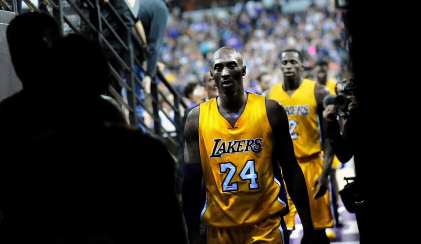 Kobe Bryant walks off the court to the locker room at halftime of a loss to the Sacramento Kings in 2016.