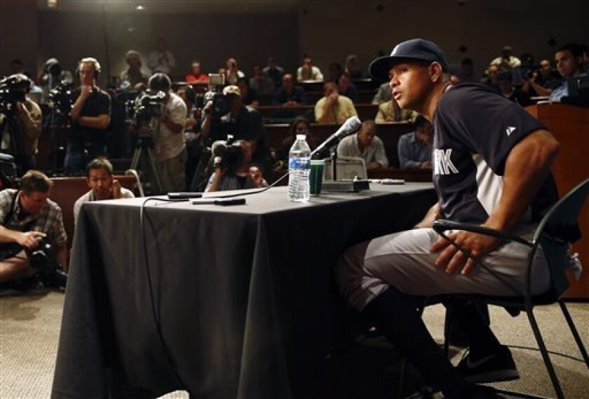 New York Yankees' Alex Rodriguez, right, talks during a news conference before the Yankees play the Chicago White Sox in a baseball game at US Cellular Field in Chicago on Monday, Aug. 5, 2013. Rodriguez was suspended through 2014 and All-Stars Nelson Cruz, Jhonny Peralta and Everth Cabrera were banned 50 games apiece Monday when Major League Baseball disciplined 13 players in a drug case, the most sweeping punishment since the Black Sox scandal nearly a century ago. (AP Photo/Charles Cherney)