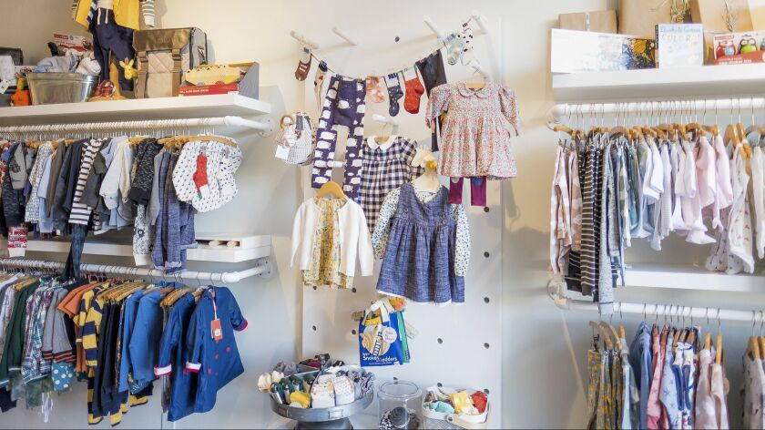 A colorful display of clothes and other children's goods inside the Lil Bit store.