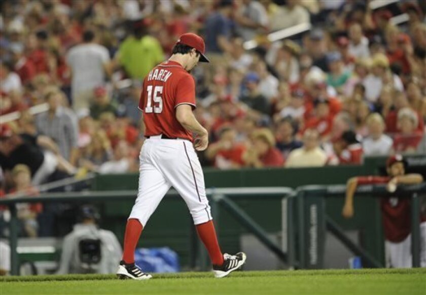 Washington Nationals starting pitcher Dan Haren (15) walks to the dugout after he was pulled from a baseball game against the New York Mets during the third inning on Saturday, Aug. 31, 2013, in Washington. (AP Photo/Nick Wass)