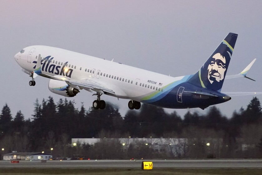 FILE - In this Monday, March 1, 2021 file photo, The first Alaska Airlines passenger flight on a Boeing 737-9 Max airplane takes off on a flight to San Diego from Seattle-Tacoma International Airport in Seattle. Many new Boeing 737 Max jetliners are still grounded by an electrical problem in a backup power-control unit. The Federal Aviation Administration said Thursday, April 22, 2021 that 106 planes worldwide are grounded, including 71 in the United States. Airlines are waiting for Boeing to come up with a plan for repairing the planes, and that plan would need FAA approval. (AP Photo/Ted S. Warren, File)