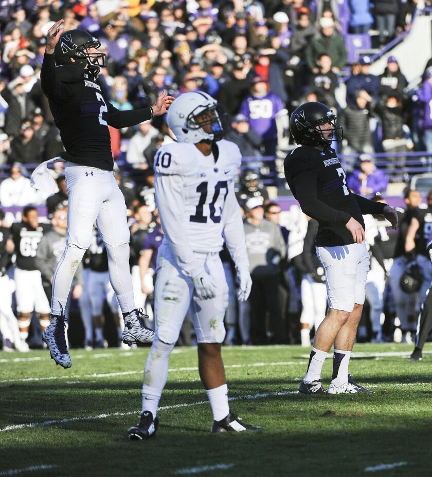 Northwestern wide receiver Christian Salem (2) and Penn State cornerback Trevor Williams (10) react after Northwestern place kicker Jack Mithchell (7) kicked the game-winning field goal in the closing second of the second half of an NCAA college football game in Evanston, Ill.,  Saturday, Nov. 7, 2