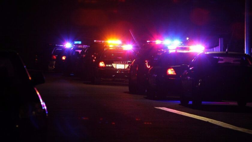 San Diego County Sheriff's Department vehicles at night.