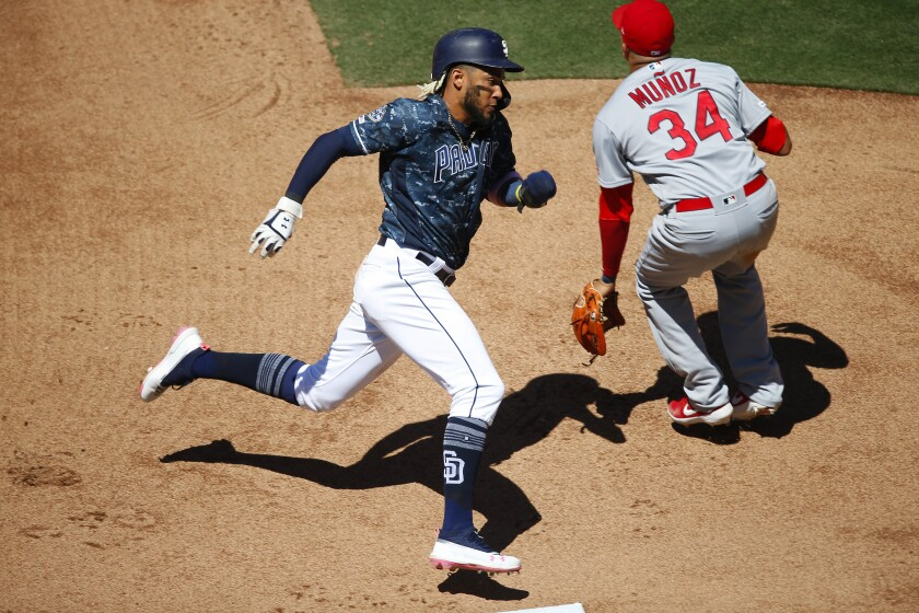 Fernando Tatis Jr., shown scoring against the Cardinals on June 30 at Petco Park, has fought back from a hamstring injury this season. He sat out Wednesday against the Rays, due to back spasms.