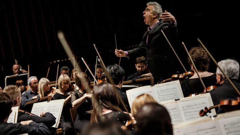 David Lockington conducts the Pasadena Symphony through Beethoven's Ninth Symphony at the Ambassador Auditorium on Saturday afternoon.