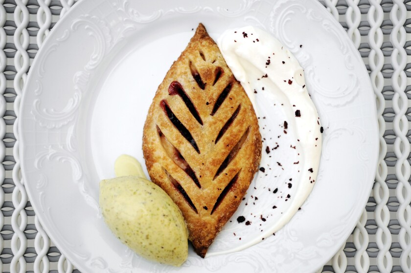 Strawberry sumac and sweet cheese pastry with pistachio ice cream, labneh cream and cured sumac from Bavel.