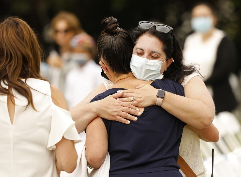 Women hug before a Yom Kippur service.