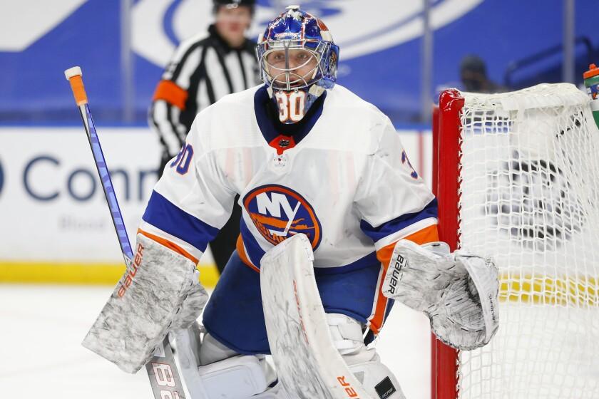 New York Islanders goalie Ilya Sorokin (30) looks on during the second period of an NHL hockey game against the Buffalo Sabres, Tuesday, Feb. 16, 2021, in Buffalo, N.Y. (AP Photo/Jeffrey T. Barnes)