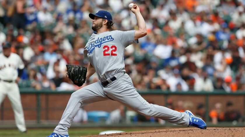 Dodgers pitcher Clayton Kershaw pitches in the bottom of the first inning against the San Francisco Giants at AT&T Park on Saturday in San Francisco.