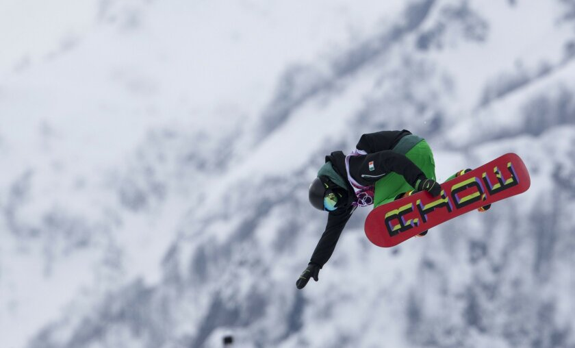 Men's Snowboard Half Pipe.  Seamus O'Connor of San Diego but riding for Ireland launches out of the half pipe during competition.