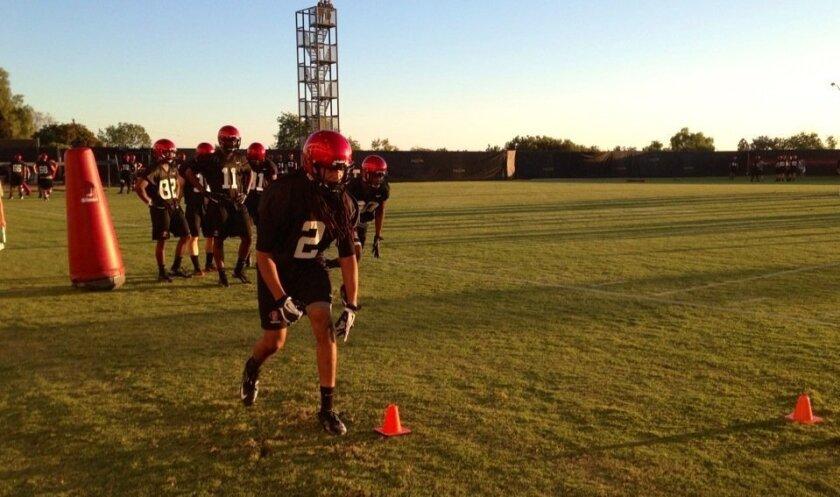 SDSU freshman receiver Christian Cumberlander runs through position drills at practice Tuesday.