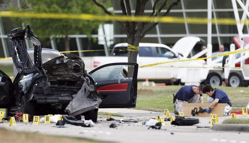 """Investigators box up an assault weapon outside the Curtis Culwell Center in Garland, Texas, in May after an attack on a """"draw Muhammad"""" cartoon contest."""