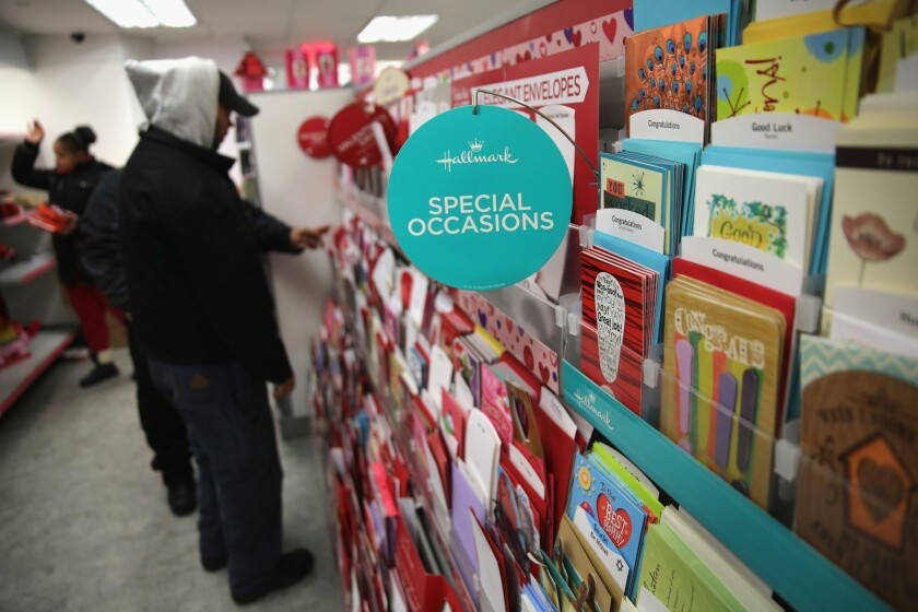 Customers choose cards and gifts on Valentine's Day.