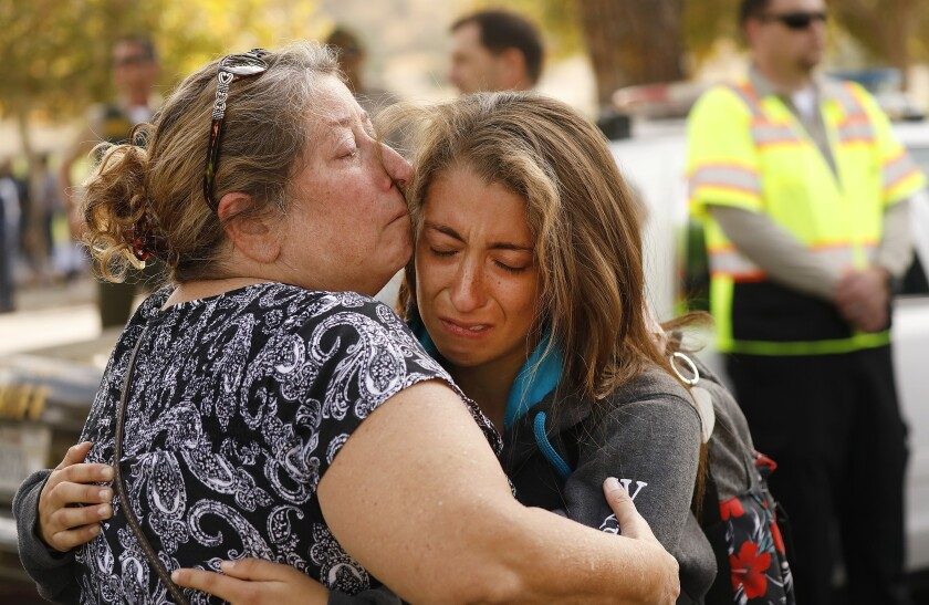 Rachel Ramirez, a 17-year-old senior at Saugus High School, gets a hug from her mother, Cheryl Ramirez, as they are reunited at a nearby park after a student opened fire on the Santa Clarita campus early Thursday.