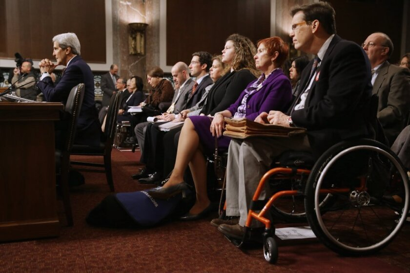 Secretary of State John F. Kerry testifies last month before the Senate Foreign Relations Committee about the Convention on the Rights of Persons with Disabilities. Kerry encouraged the committee to vote for adoption of the treaty, which he says will bring standards enjoyed by handicapped and disabled people in the United States to the international community.
