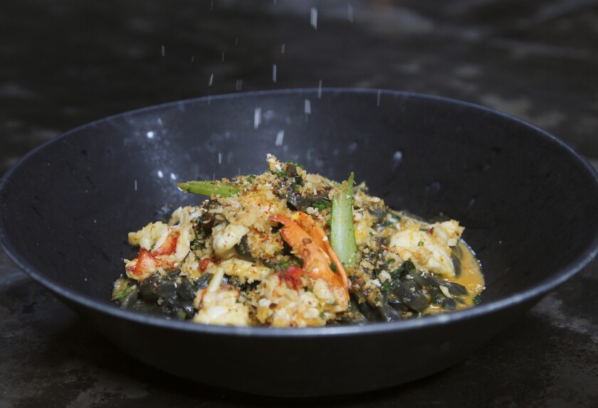 Parmesan cheese (!) is sprinkled on to black garlic udon noodles with lobster, chili, lobster bisque, and choy sum, a rule-breaking dish from Animae executive chef Joe Magnanelli.