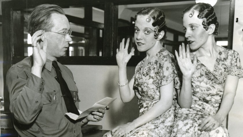 """A photo of Daisy and Violet taking the American citizenship oath in Leslie Zemeckis' """"Bound by Flesh."""""""