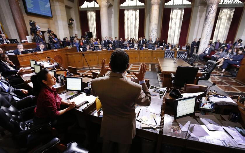 L.A. City Council President Herb Wesson, center, speaks at City Hall on June 3 before the council voted on an ordinance to raise the minimum wage in Los Angeles to $15 per hour by 2020.