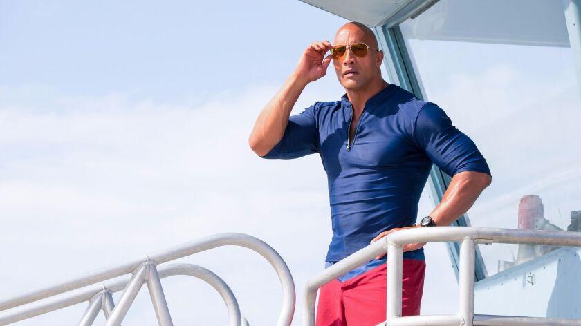 "Dwayne Johnson as Mitch Buchannon in the film ""Baywatch."""